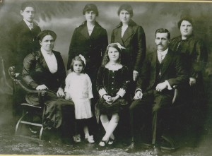 Family portrait of the Payne Family Front row in order: Florence , Hilda, Ada, Walter snr Back row: Walter jnr, Vera, Elsie and Violey. Shared by trishandjeff 16 Jun 2013 on Ancestry.com