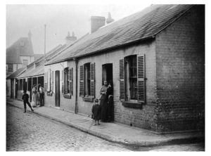 Athlone Place, Ultimo, c.1900. Athlone Place was resumed by Council in 1906, when some 400 dwellings and a maze of tiny lanes were removed. The area was subject to flooding and it was considered a deplorable slum. This photo shows two groups of semi-detached, single-storey buildings, with neighbours and children standing in their doorways chatting. (image: City of Sydney Archives, CRS 51/6) http://history.cityofsydney.nsw.gov.au/sydneystreets/Lost_Streets/Laneways/51_1_6.html